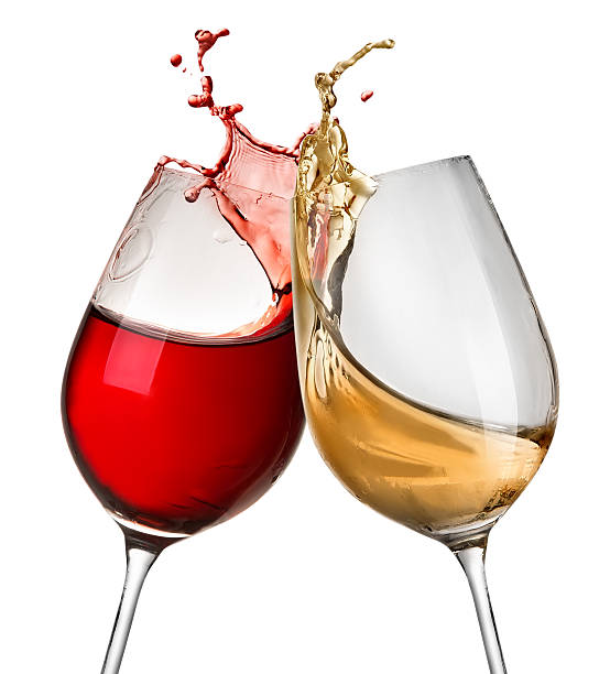 Splashes of wine in two wineglasses isolated on white